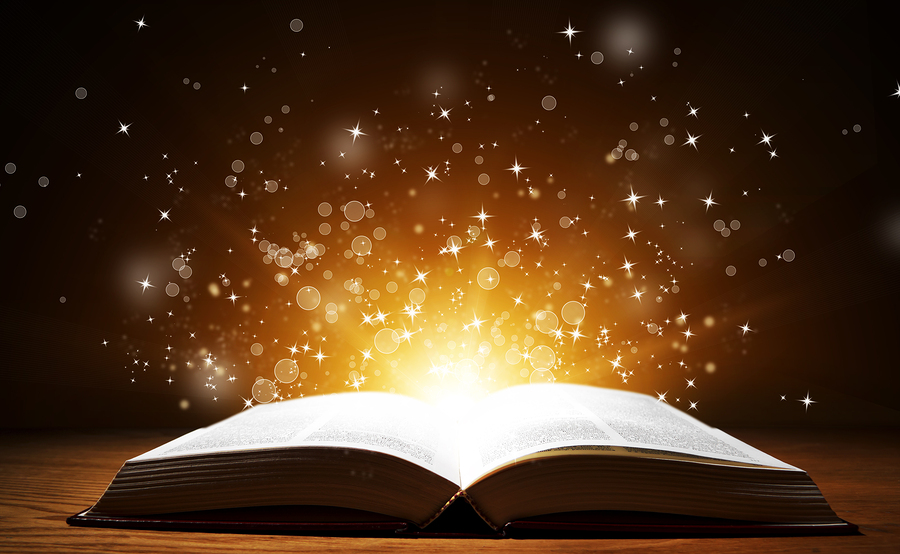 Old open book with magic light and falling stars on wooden table | The  House Guest
