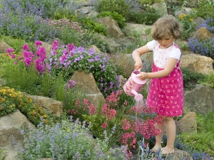 bigstock_Cute_girl_watering_flower_in_t_16357925